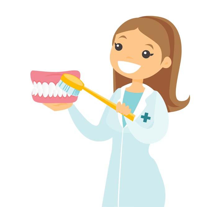 female dentist demonstrating how to brush teeth