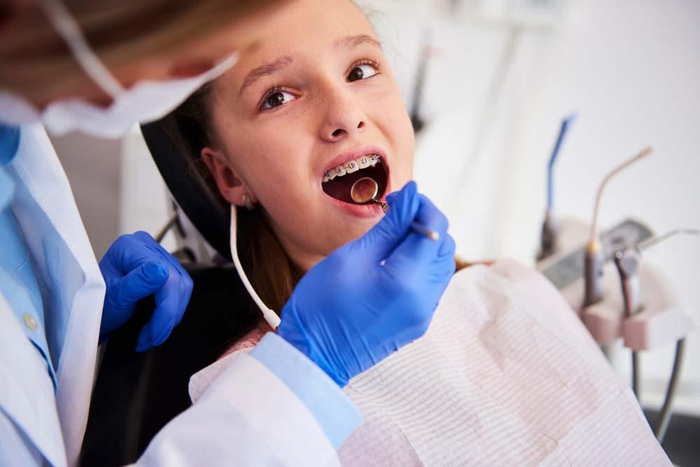 girl having her braces tightened