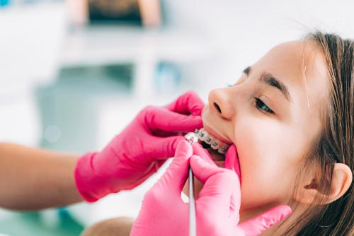 Girl getting braces tightened